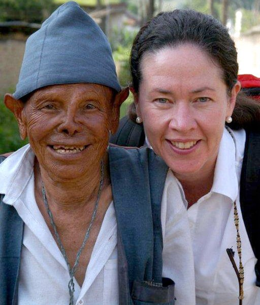 Dr Maggie Burgess with a leprosy-affected person